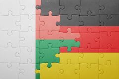Puzzle with the national flag of germany and madagascar. Concept Royalty Free Stock Photos