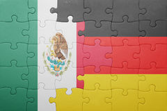 Puzzle with the national flag of germany and mexico. Concept stock images