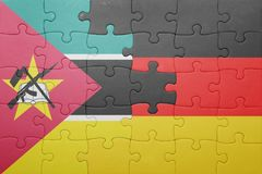 Puzzle with the national flag of germany and mozambique Stock Photos