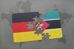 Puzzle with the national flag of germany and mozambique on a world map background. 3D illustration Royalty Free Stock Image