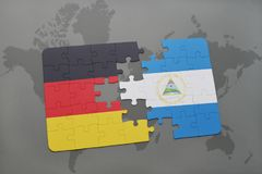 Puzzle with the national flag of germany and nicaragua on a world map background. 3D illustration royalty free stock images