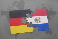 Puzzle with the national flag of germany and paraguay on a world map background. 3D illustration royalty free stock photos