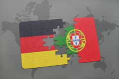 Puzzle with the national flag of germany and portugal on a world map background. 3D illustration royalty free stock images