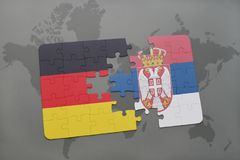 Puzzle with the national flag of germany and serbia on a world map background. 3D illustration stock images