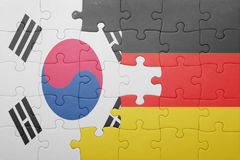 Puzzle with the national flag of germany and south korea. Concept stock images