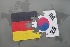 Puzzle with the national flag of germany and south korea on a world map background. 3D illustration stock photo
