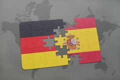 Puzzle with the national flag of germany and spain on a world map background. 3D illustration stock photography