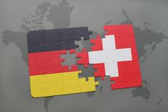 Puzzle with the national flag of germany and switzerland on a world map background. 3D illustration royalty free stock images