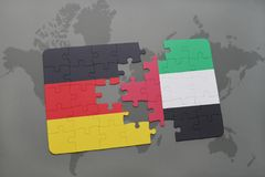 Puzzle with the national flag of germany and united arab emirates on a world map background. 3D illustration royalty free stock photos