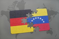 Puzzle with the national flag of germany and venezuela on a world map background. 3D illustration stock images