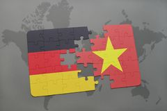 Puzzle with the national flag of germany and vietnam on a world map background. 3D illustration royalty free stock photography