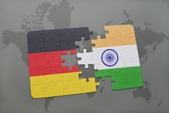 Puzzle with the national flag of germany and india on a world map background. Puzzle with the national flag of germany and on a world map background. 3D royalty free stock images