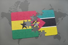 Puzzle with the national flag of ghana and mozambique on a world map. Background. 3D illustration Stock Photography