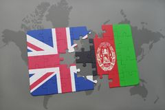 Puzzle with the national flag of great britain and afghanistan on a world map background. Concept Stock Image
