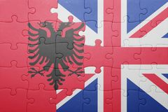 Puzzle with the national flag of great britain and albania. Concept Stock Photography