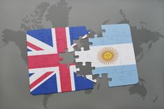 Puzzle with the national flag of great britain and argentina on a world map background. Royalty Free Stock Photography