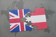 Puzzle with the national flag of great britain and austria on a world map background Stock Photo