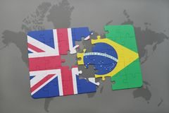 Puzzle with the national flag of great britain and brazil on a world map background. Stock Photography