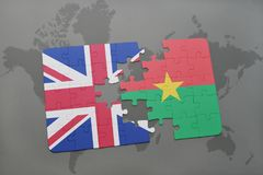 Puzzle with the national flag of great britain and burkina faso on a world map background. Royalty Free Stock Image