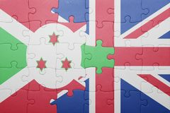 Puzzle with the national flag of great britain and burundi Royalty Free Stock Photos