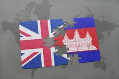 Puzzle with the national flag of great britain and cambodia on a world map background. Royalty Free Stock Photos
