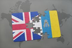 Puzzle with the national flag of great britain and canary islands on a world map background. Concept Royalty Free Stock Photography