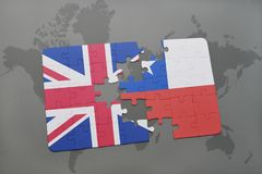 Puzzle with the national flag of great britain and chile on a world map background. Royalty Free Stock Image