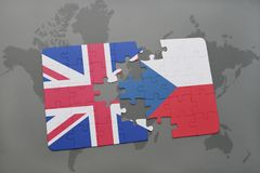 Puzzle with the national flag of great britain and czech republic on a world map background Stock Photo