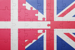 Puzzle with the national flag of great britain and denmark Royalty Free Stock Images