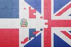 Puzzle with the national flag of great britain and dominican republic Royalty Free Stock Photography