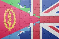 Puzzle with the national flag of great britain and eritrea Stock Photography