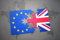 Puzzle with the national flag of great britain and european union on a world map background Royalty Free Stock Images