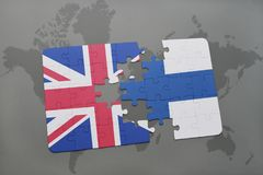 Puzzle with the national flag of great britain and finland on a world map background Stock Image