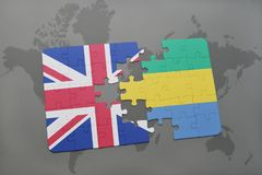 Puzzle with the national flag of great britain and gabon on a world map background. Stock Photo