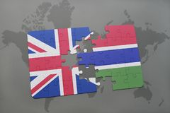 Puzzle with the national flag of great britain and gambia on a world map background. 3D illustration Stock Photo