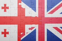 Puzzle with the national flag of great britain and georgia Royalty Free Stock Image
