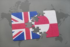 Puzzle with the national flag of great britain and greenland on a world map background. Royalty Free Stock Image