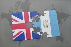 Puzzle with the national flag of great britain and guatemala on a world map background. Stock Photo