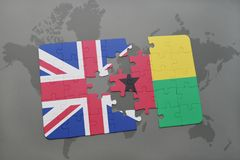Puzzle with the national flag of great britain and guinea bissau on a world map background. Royalty Free Stock Images