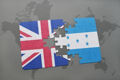 Puzzle with the national flag of great britain and honduras on a world map background. Stock Photos