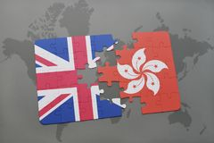 Puzzle with the national flag of great britain and hong kong on a world map background. Concept Royalty Free Stock Image