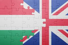 Puzzle with the national flag of great britain and hungary. Concept Royalty Free Stock Images