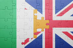 Puzzle with the national flag of great britain and ireland. Concept Royalty Free Stock Images
