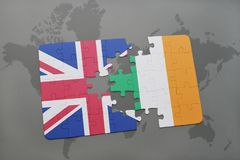 Puzzle with the national flag of great britain and ireland on a world map background Royalty Free Stock Photos