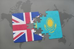 Puzzle with the national flag of great britain and kazakhstan on a world map background. Concept Royalty Free Stock Photos