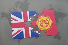 Puzzle with the national flag of great britain and kyrgyzstan on a world map background. Stock Photo
