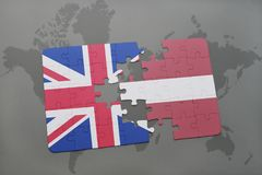 Puzzle with the national flag of great britain and latvia on a world map background Royalty Free Stock Photography