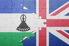 Puzzle with the national flag of great britain and lesotho Royalty Free Stock Images