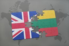 Puzzle with the national flag of great britain and lithuania on a world map background Royalty Free Stock Photo