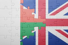 Puzzle with the national flag of great britain and madagascar. Concept Stock Image